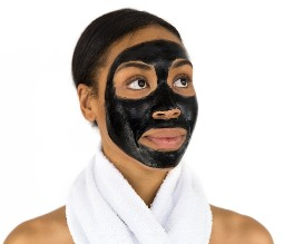 Anderson AK esthetician client with face mask